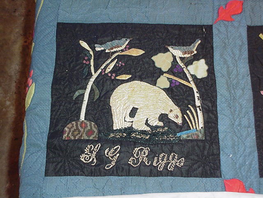 Songbirds and a white bear are pictured on one of the quilt squares. Image courtesy of Jessica Hack Textile Restoration.