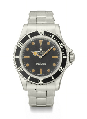 Sharp teeth were cut into the bezel of James Bond's Rolex watch. When activated the bezel spun to function as a miniature buzz saw. The movie prop sold for more than $245,000. Courtesy Christie's Images Limited 2011.