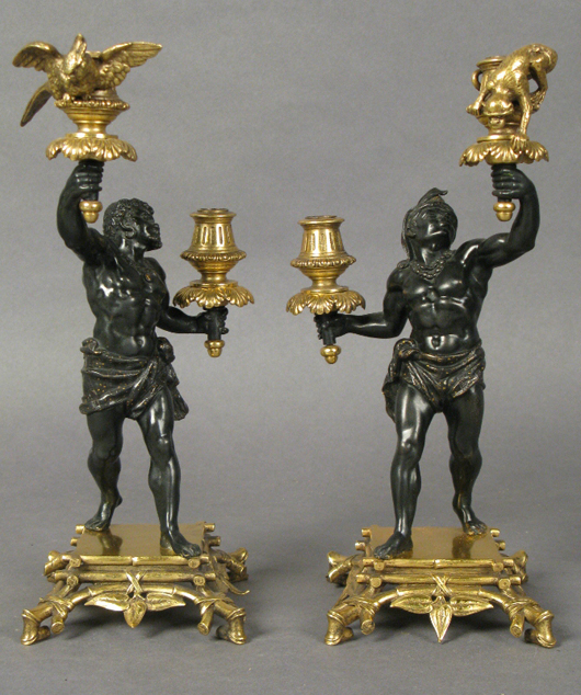 Patinated dore bronze Nubian warrior candlesticks, Austrian, 19th century, possibly Bergman, 10½ inches tall, est. $4,000-$5,000 pair. Sterling Associates image.