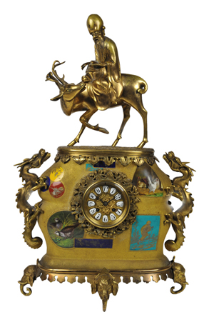 Japy Freres bronze dore Oriental-themed figural mantel clock, 26 3/4 x 16 1/2 x 10 inches. Estimate: $4,000-$6,000. Image courtesy of Morton Keuhnert Auctioneers & Appraisers.