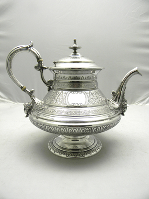 French Victorian mask decorated silver coffeepot (27ozt) made by E. Hugo. Image courtesy of Wilson's Auctioneers & Appraisers.