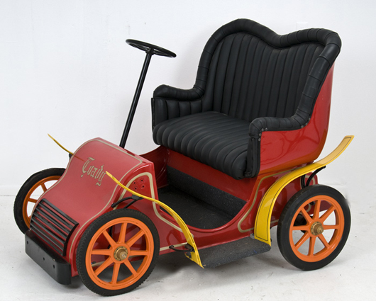 Disneyland 'Mr. Toad's Wild Ride' vehicle, leather upholstered back seat, 58 inches long. Estimate $1,000-$1,500. Abell Auctions image.