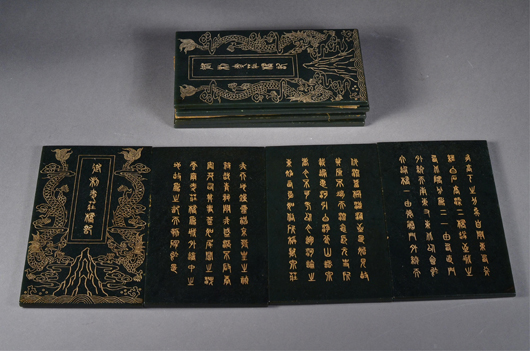 Eight Chinese spinach green jade tablets with Qianlong Mark achieved $6,655. 888 Auctions image.