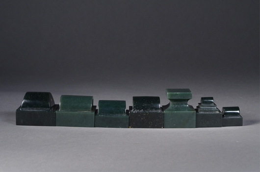 Set of eight Chinese spinach green square seals with Qianlong Mark brought in $3,327. 888 Auctions image.