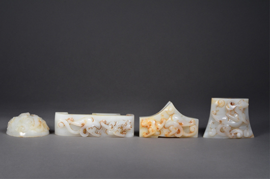 Four finely carved Chinese Hetian imperial jade pieces found its sale value of $7,260. 888 Auctions image.