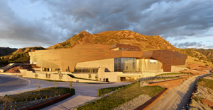 The setting sun illuminates the copper façade on the Natural History Museum of Utah's new building, the Rio Tinto Center. The copper, mined at Kennecott Utah Copper, is offset in sections to represent Utah's geologic formations. Image courtesy of NHMU/Stuart Ruckman.