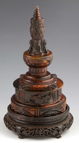Rare rhinoceros horn Buddhist stupa, China, 19th to 20th century, on carved wood stand, 7 1/2 inches high.Estimate: $30,000-$50,000. Image courtesy of Kaminski Auctions.
