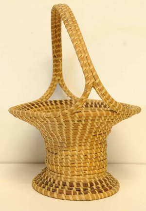 Under current South Carolina law, sweetgrass baskets such as this one of Charleston origin, do not incur state sales tax. Image courtesy of LiveAuctioneers.com Archive and Ivy Auctions.