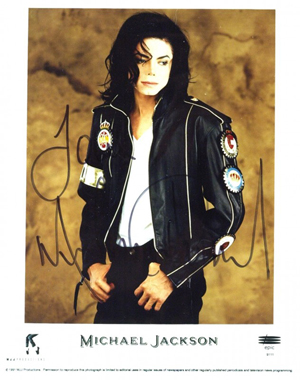An 8-by-10 promotional photograph signed 'Love, Michael Jackson.' Image courtesy of LiveAuctioneers.com Archive and The Written Word Autographs.
