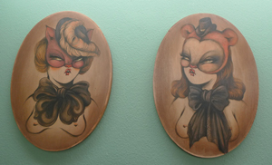 Two of Miss Van's pouting women, on wood. Painting by Miss Van, photography courtesy of Inoperable Gallery.
