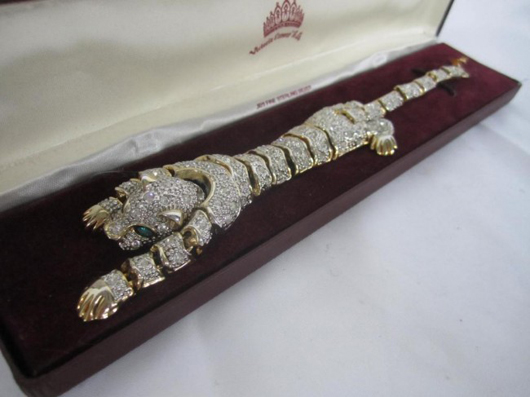 Jaguar form costume jewelry bracelet, gilt metal and rhinestones with one green eye, with certificate of authenticity from the estate of Rue McClanahan. Estimate: $300-$500. Image courtesy of Hutter Auction Galleries.