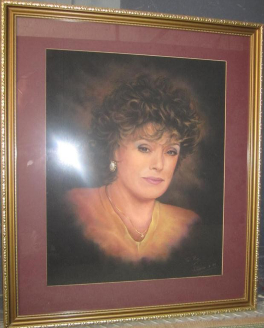 Portrait of Rue McClanahan by John Curran, pastel on paper, inscribed 'To Rue' signed John Curran lower right, matted and framed, 31 x 26 1/2 inches, together with documents and a photograph of McClanahan with artist. Estimate: $1,000-$1,500. Image courtesy of Hutter Auction Galleries.