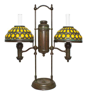 Tiffany Studios bronze and glass double student lamp, 29 inches high, each shade 10 1/4 inches diameter. Estimate: $15,000-$25,000. Image courtesy of Leslie Hindman Auctioneers.