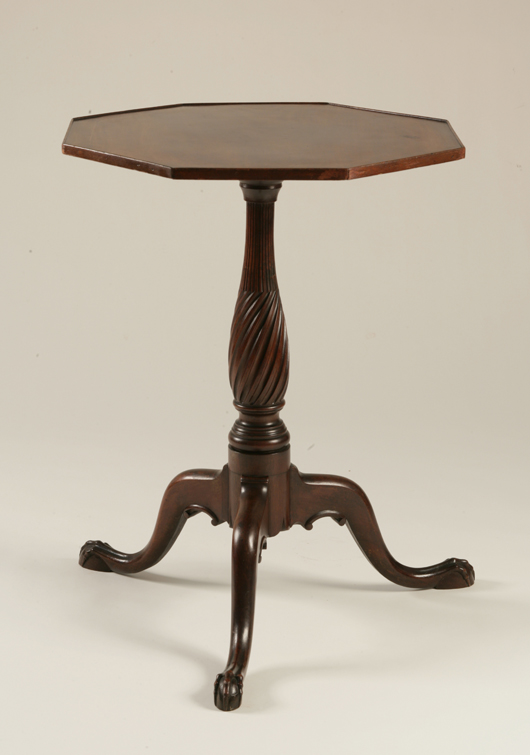 Chippendale spiral and fluted and C-scrolled carved and inlaid candle stand with octagonal top, eastern New England, circa 1780. Est. $10,000-$20,000. Image courtesy of Keno Auctions.