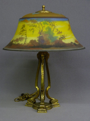 Signed Pairpoint reverse painted lamp, artist signed 'L.H. Gorman' on Exeter-style shade and d3084 Pairpoint base, height 21 inches, diameter 17 inches, mint original condition. Estimate: $1,500-$2,500. Image courtesy of Jay Anderson Antique Auction.