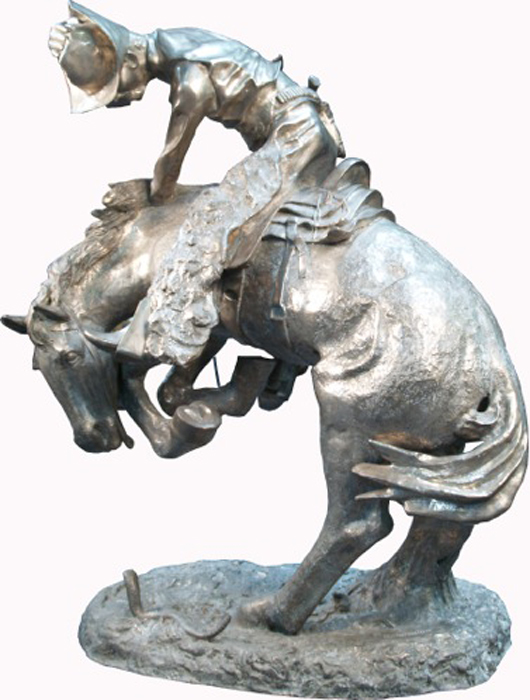 'The Rattlesnake,' nickel statue, copy of original Frederic Remington sculpture, circa 1905, 62 inches high. Estimate: $2,000-$20,000. Image courtesy of Victorian Casino Antiques.