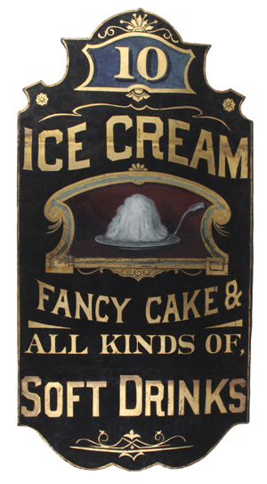 Painted tin on wood sign advertising confections and beverages, 5ft. tall, top lot of the sale at $46,000. Noel Barrett Auctions image.