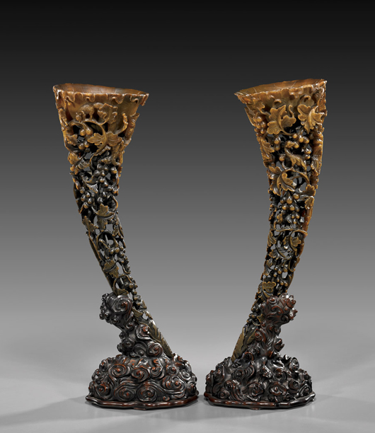 Pair of carved rhinoceros horn vessels, each 19 1/4 inches high, sold well above estimate in 2011 for $271,000. Image courtesy of I.M. Chait.