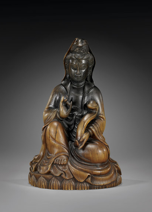 Carved rhinoceros horn figure of Guanyin atop a lotus base, 6 3/4 inches, estimated at $30,000-$50,000, sold for $232,000 in 2011. Image courtesy of I.M. Chait.