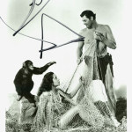 Cheetah, Tarzan's chimp, 'autographed' this photograph, which also pictures Johnny Wiessmuller and Maureen O'Hara. Image courtesy of LiveAuctioneers Archive and Signature House.