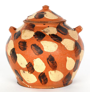 This earthenware sugar bowl is a rare Alamance County, N.C., piece, originally bought by Titus Geesey from Joe Kindig Jr. in 1930. Estimate: $10,000-$20,000. Image courtesy of Pook & Pook Inc.