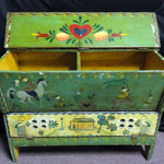 Pennsylvania polychrome painted folk art storage chest with perforated bottom drop drawer. Image courtesy of Specialists of the South.