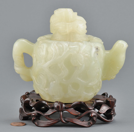 The auction includes more than 100 lots of Asian jade, snuff bottles, and other material, including this jade teapot carved in the Mughal style (est. $800-$1,200). Image courtesy of Case Antiques Auction.