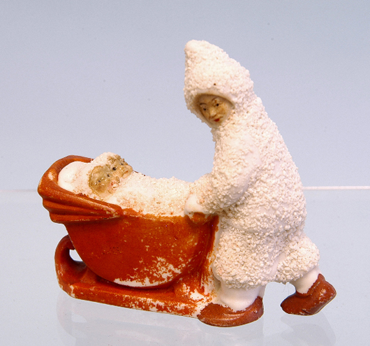 Collectors search out unusual presentations, such as this Snow Mom pushing her twins in a sleigh pram, which brought $357.50. Courtesy LiveAuctioneers.com Archive and Bertoia Auctions.