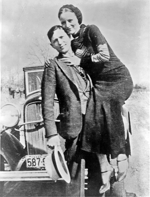 Clyde Barrow and Bonnie Parker in a photograph recovered in March 1933 at their hideout in Joplin, Mo. Image courtesy of Wikimedia Commons.