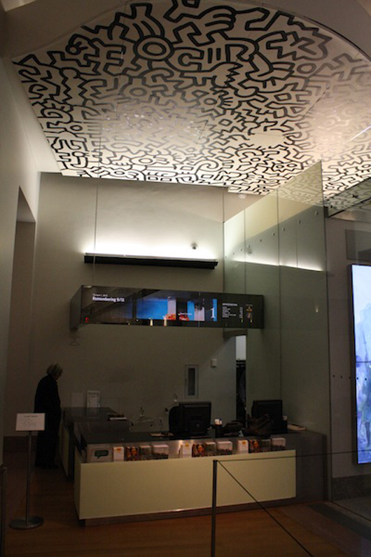 The admissions area of the New-York Historical Society sits beneath a panel from Keith's Pop Shop. Art by Keith Haring; photography by Kelsey Savage.