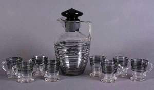 Steuben glass pitcher and eight glasses, American, 20th century. Estimate $800-$1,200. Image courtesy of Stefek's Auctioneers & Appraisers.