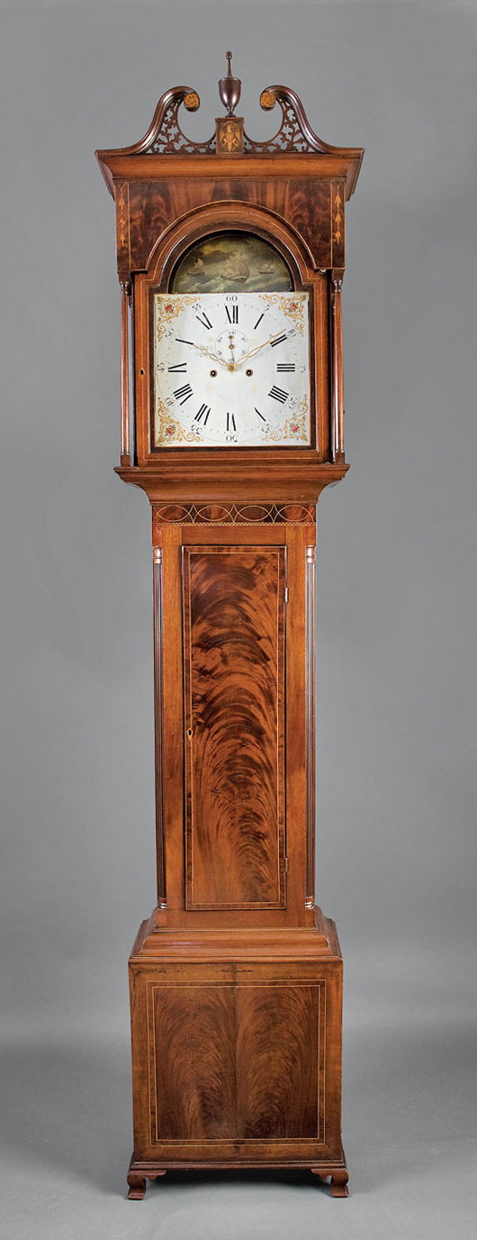 American Chippendale inlaid and carved mahogany tall-case clock, circa 1760, Baltimore, tole painted face flanked by inlaid columns, height 104 1/4 inches, width 23 1/4 in., depth 11 1/2 inches. Estimate: $25,000-$35,000. Image courtesy of Neal Auction Co.