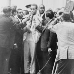 Malcolm X (center) at a 1964 press conference. Photo by Herman Hiller, New York World Telegram staff photographer, Library of Congress, New York World-Telegram & Sun Collection.