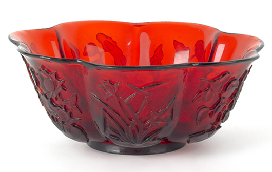 Chinese carved ruby Peking glass bowl, 3 inches high, 7 3/4 inches diameter. Image courtesy Pook & Pook Inc.