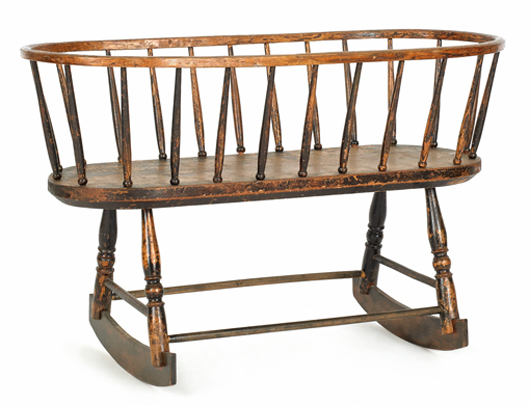 Windsor rocking cradle, circa 1800, 25 inches high x 39 1/2 inches long. Image courtesy Pook & Pook Inc.