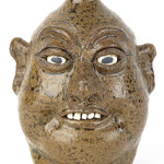 Georgia stoneware face jug by Lanier Meaders, signed on base, 9 1/4 inches high. Image courtesy Pook & Pook Inc.