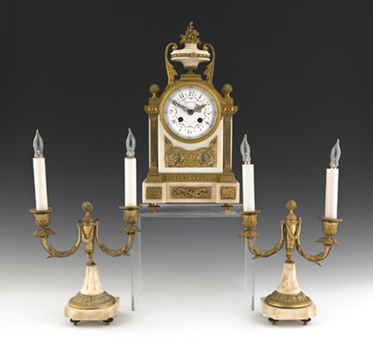 """French ormolu and marble three-piece clock garniture, circa 1900, the works stamped """"AD Mogin,"""" 15 1/4 inches high. Image courtesy Pook & Pook Inc."""