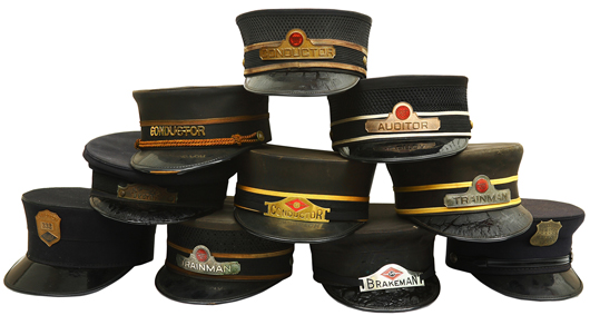 These antique and vintage railroad employee caps represent such occupations as Conductor, Brakeman, Auditor, and Wells Fargo Railway Post Office Agent. A&S image.