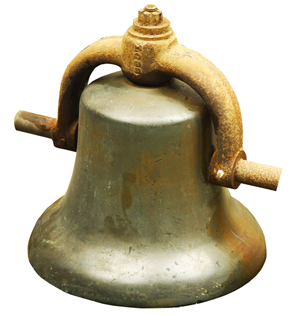 The 'heavy metal' section of the sale includes steam locomotive engine bells (as shown), spittoons, brass railroad locks and keys; plus an extremely rare cast-iron caboose stove. A&S image.