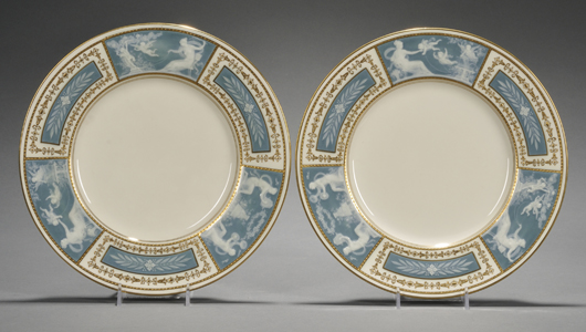 Decorative service plates, such as this ethereal Minton pair decorated by Alboin Birks circa 1924 set the style at formal meals. The lot brought $2489 last year. Image Courtesy Skinner Auctions.