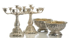From a superb selection of extensively chased and embossed Tiffany & Co. silver, a pair of circa-1882 nine-light candelabra with triton, seahorse and mermaid motif, $111,600; and a pair of circa-1882 center bowls, $134,400. Morphy Auctions image.