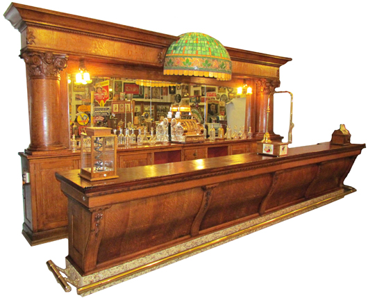 Rare Brunswick saloon front and bar back, made circa 1895-1905 of quartersawn oak.  Image courtesy Showtime Auction Services.