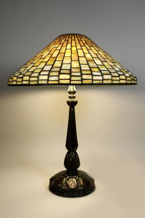 Louis Comfort Tiffany geometric table lamp, bronze turtleback base, signed 'Tiffany Studios New York #1493' on shade, 'Tiffany Studios #587' on base, 25 inches high, 20 1/4-inch-diameter shade. Estimate $8,000-$12,000. Image courtesy Kaminski Auctions.