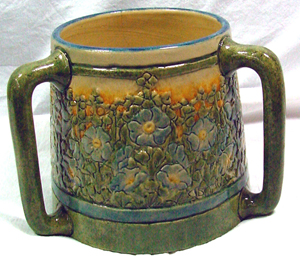 Newcomb College pottery loving cup with rare orange glaze, designed by Leona Nicholson. John W. Coker image.