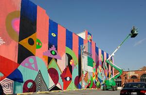 Maya Hayuk creates a mural for Open Walls Baltimore. Mural by Maya Hayuk, photography courtesy of Martha Cooper.