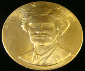 Mark Twain commemorative gold coin issued by the U.S. Mint, still housed in the original box. Image courtesy of Tim's, Inc.