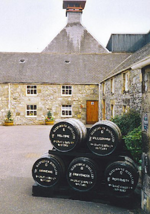Whisky barrels in the courtyard of Glenfiddich Distillery, Dufftown, Scotland. Note the distinctive pagoda cap on the distillery roof to release the 'aromas.' Photo by Colin Smith, licensed under the Creative Commons Attribution-Share Alike 2.0 Generic license.