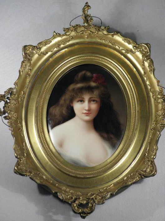 KMP porcelain plaque, oval form, hand-painted portrait of a woman, stamped on reverse 'KPM' and marked 'Germany,' gilt plaster frame measures 16 1/2 inches high by 14 inches wide. Estimate: $1,200-$1,600. Image courtesy Auctions Neapolitan.