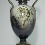 KPM Berlin porcelain hand-painted urn, scene with multiple cherubs, circa 1763-1837, small repair to flower at top, 23 3/4 inches tall by 12 1/2 inches wide. Estimate: $2,500-$3,500. Image courtesy Auctions Neapolitan.