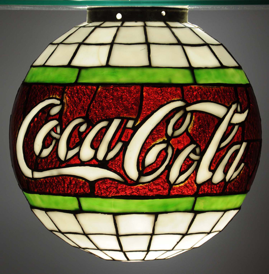 Leaded-glass Coca-Cola hanging globe with 200 glass panels, late teens to early 1920s, est. $12,000-$18,000. Morphy Auctions image.